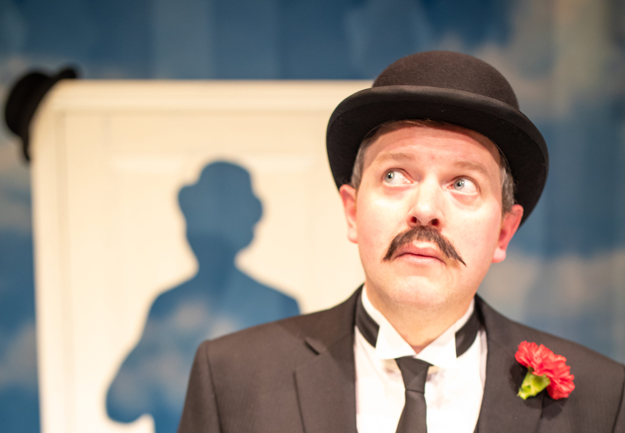 Photo of Miles Jupp in character