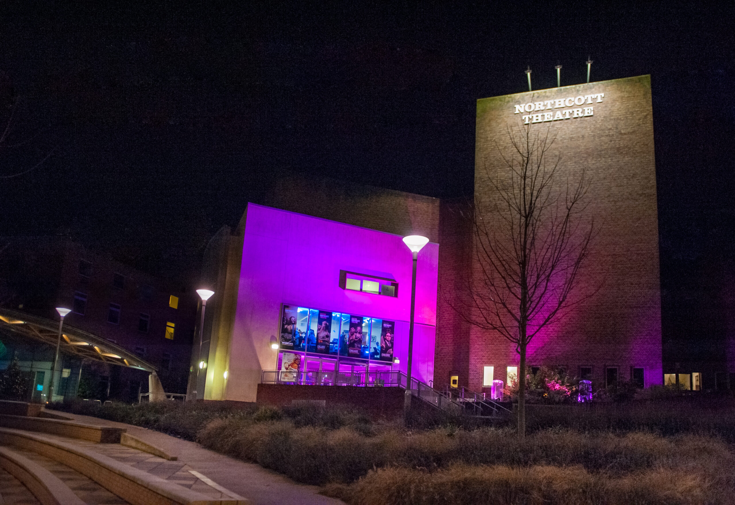 Photo at night of the Northcott Theatre building