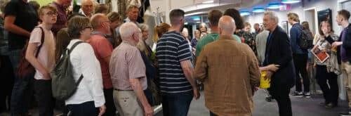 Photo of Sir Ian McKellan greeting people in the Northcott foyer