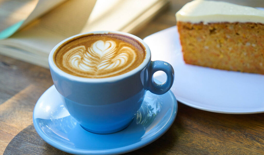 Cup of coffee with a slice of cake