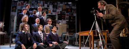 Photo of The History Boys cast in costume performing onstage