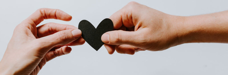 Two hands holding a love heart