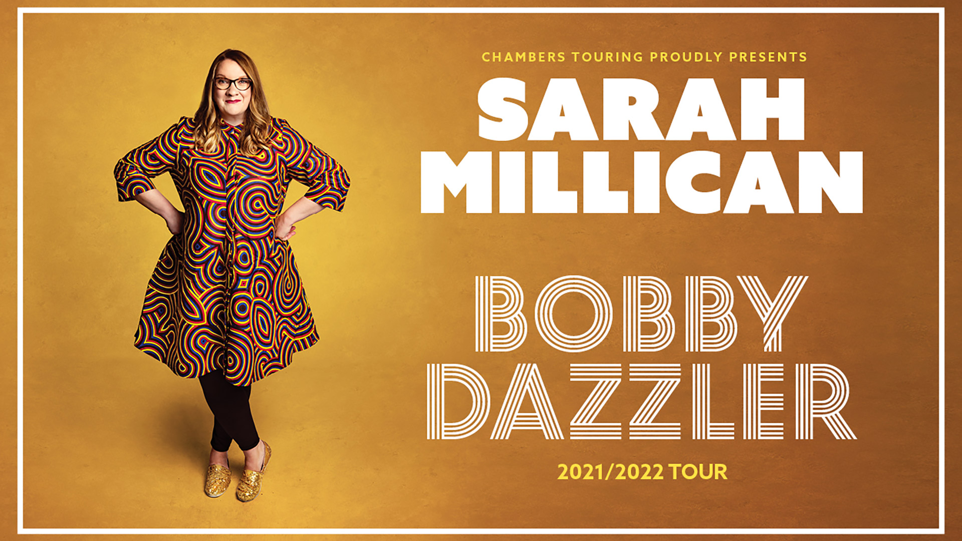 Sarah Millican in a multi-coloured dress with graphic design and sparkling gold shoes against a warm golden yellow background
