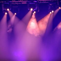 Stage lights shining through smoke