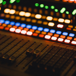 A close of of the lights and switches of a soundboard
