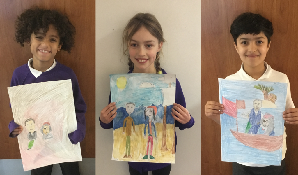 Three year 4 and 5 students, proudly showing their Treasure Island drawings