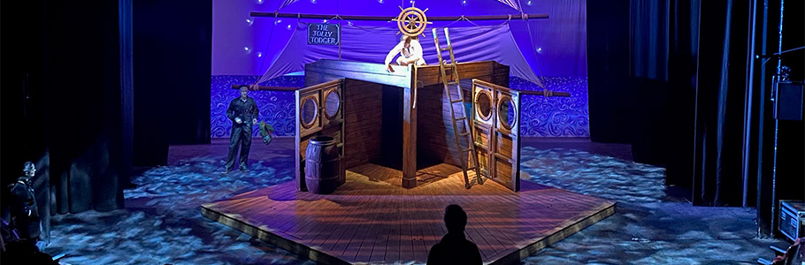 Set of Treasure Island during technical rehearsal, showing lights creating under water effect