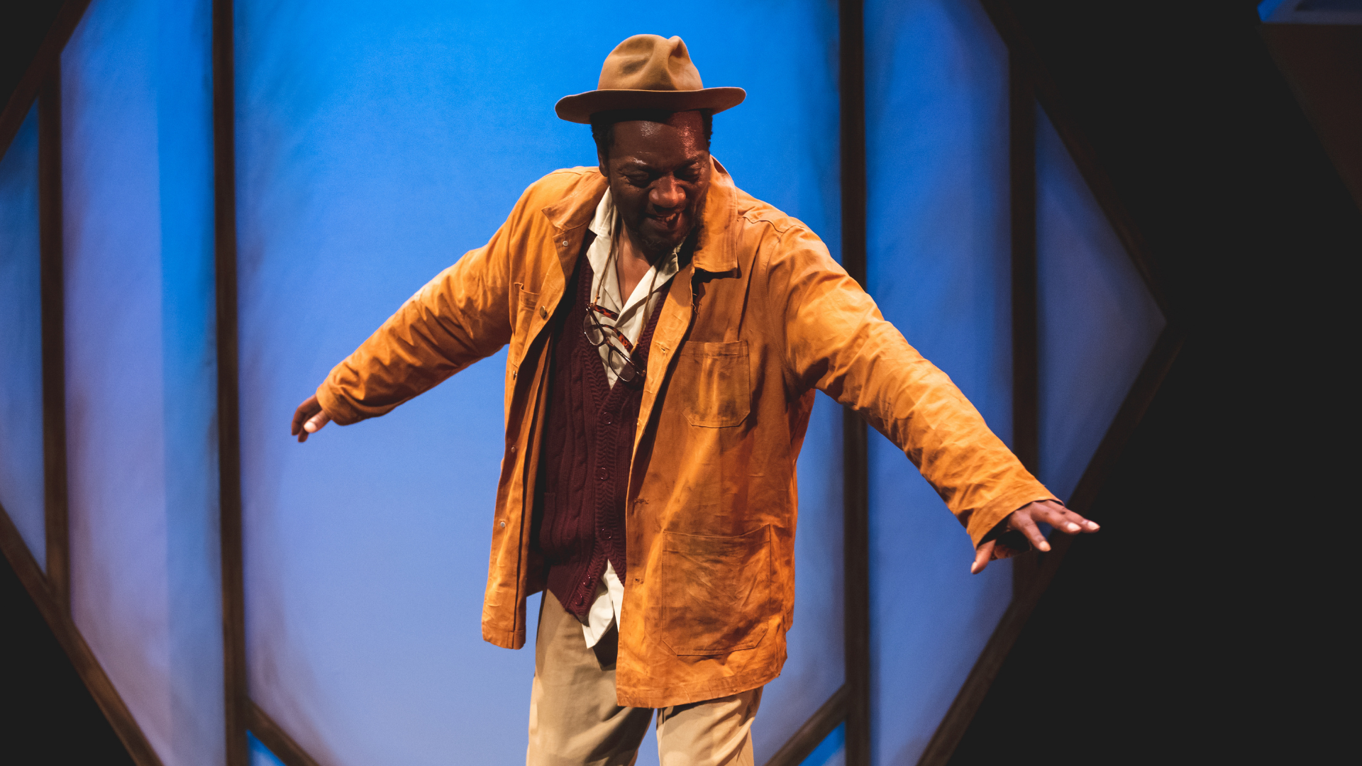 The Honey Man Production Photo: Honey Man (Everal Walsh) dances in front of a blue projection