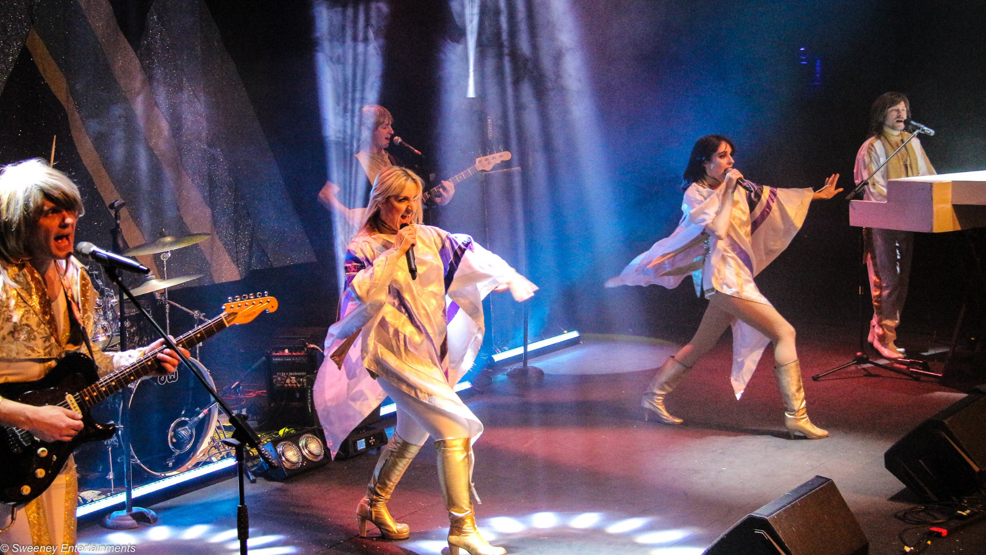 ABBA tribute band on stage singing