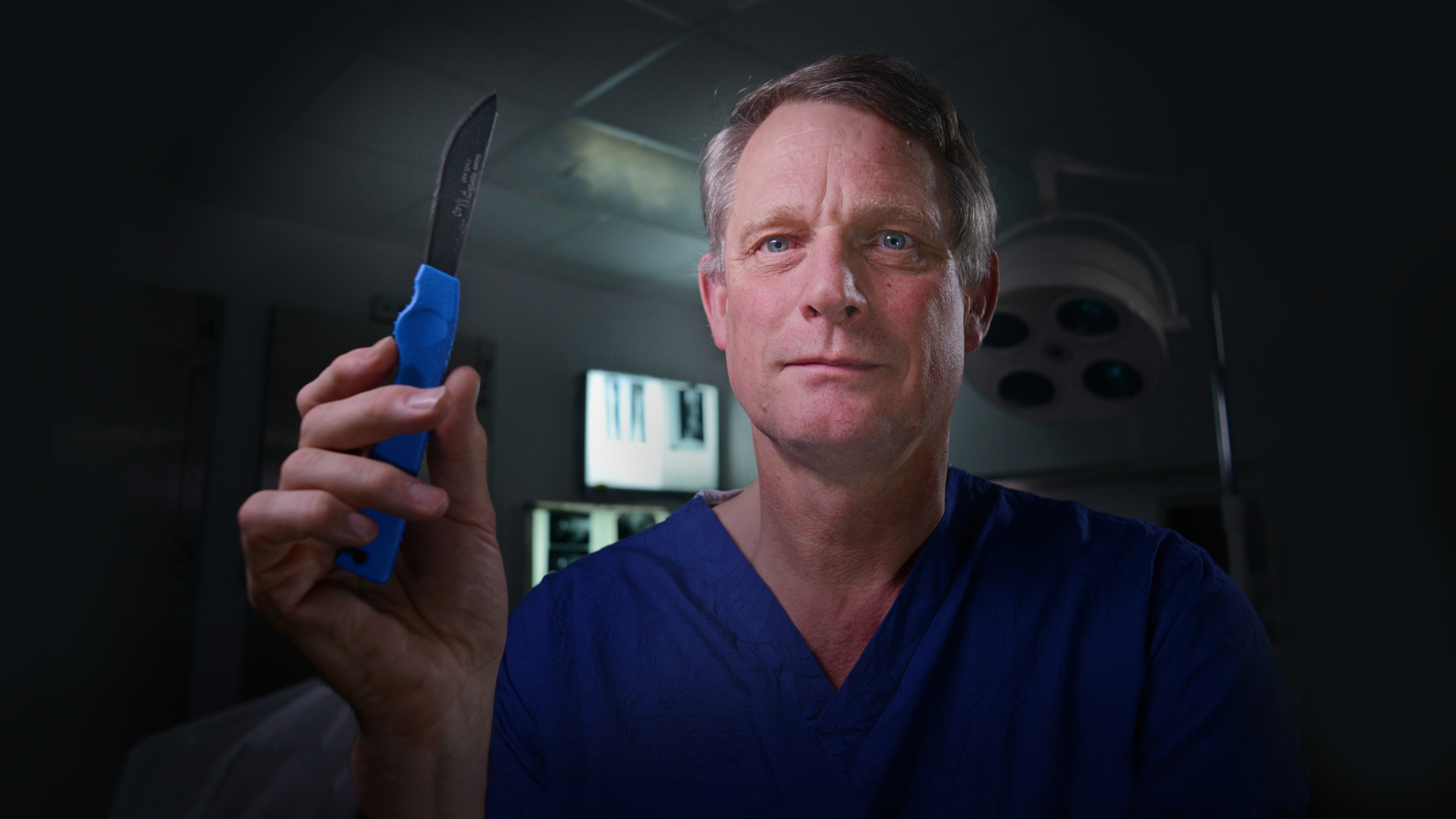Dr Richard Shepherd holding up a scalpel - promotional image