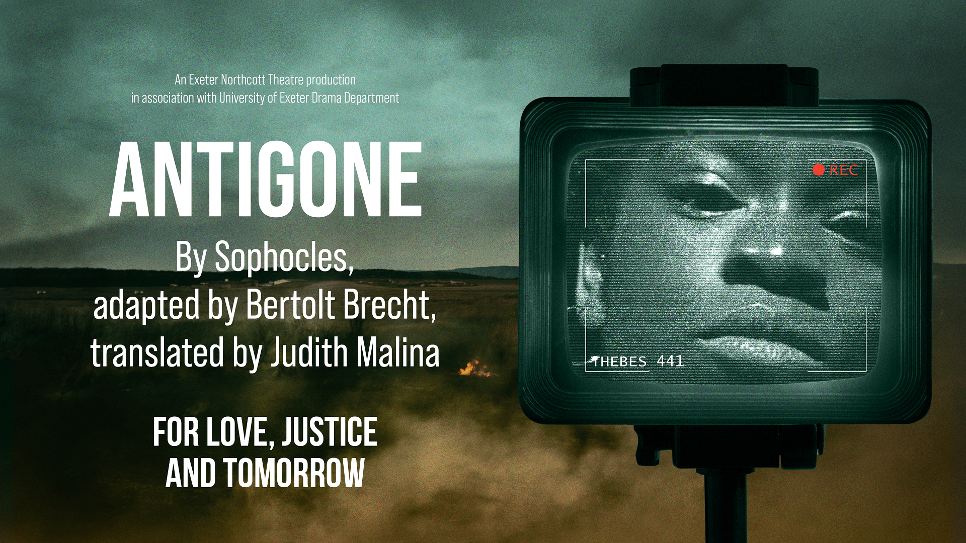 Antigone promotional image - a young woman on a security camera looking in closely and intensely