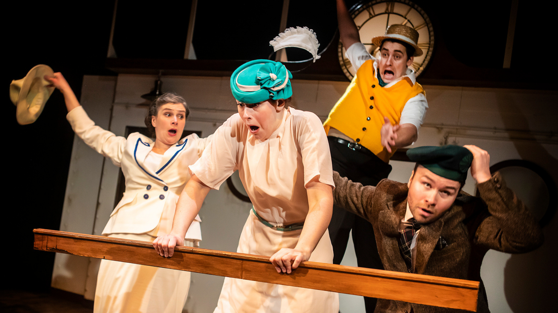 4 characters looking scared at the edge of a boat railing