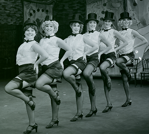 Archive image of Guys and Dolls - a line of women dancing, including a young Celia Imrie and Imelda Staunton