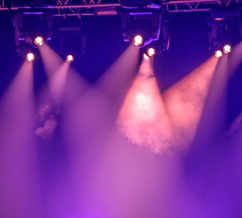 Theatre spotlights shining through smoke