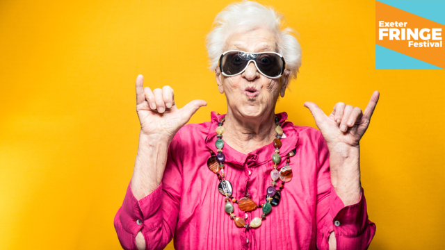 Promotional image for Cafe Theatre: An older woman with white hair in a vibrant pink shirt against an equally vibrant yellow background giving us the